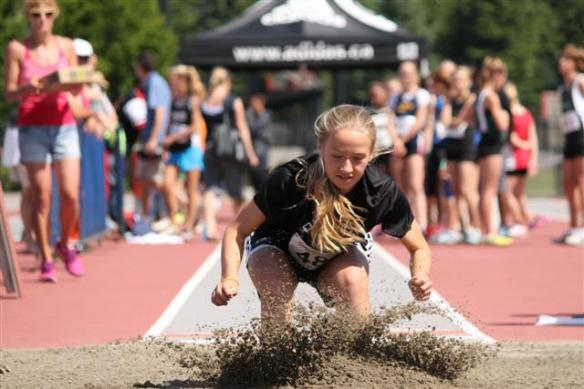 Emma Celle competes in long jump at Jesse Bent