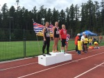 Jeneviève (left) and Brianna (far right) receive medals for javelin