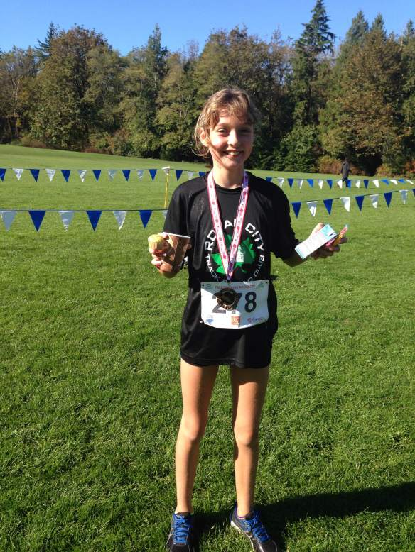 Emily Bowles takes Bronze Medal in 11 year old girls' category at Festival of Cross Country 3.0km race